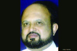 The chief minister of India's strife torn state of Assam, Prafulla Kumar Mahanta, smiles during a me..